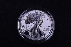 American Silver Eagle Reverse Proof Coin 2019-S rare with mintage of 30000 produced with special finish on a black background.  The obverse of the coin is shown with the 2019 date shown on the front.
