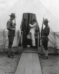 American soldier gets throat sprayed to prevent influenza. Dec. 1918. Medical tent at Love Field, Dallas, Texas, during the 1918-19 'Spanish' Influenza pandemic.