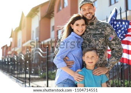 American soldier with family outdoors. Military service