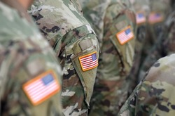 American Soldiers and Flag of USA on soldiers arm. US Army. Veteran Day