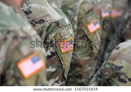 Photo of  American Soldiers and Flag of USA on soldiers arm. US Army. Veteran Day