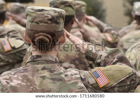 Photo of  American Soldiers Salute. US Army. Military forces of the United States of America. US army. Memorial day. Veterans Day.