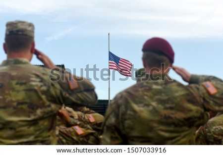 American Soldiers Saluting US Flag. US Army #1507033916