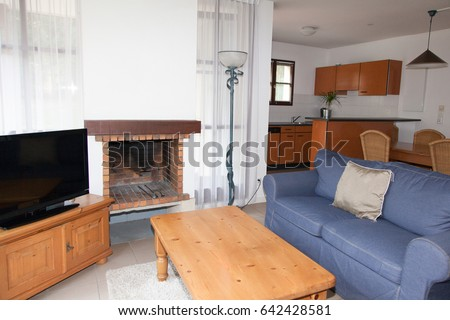 American-style living room with kitchen, dining room and TV #642428581