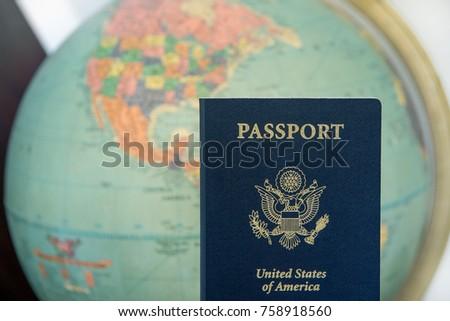 American travel document passport with world background. #758918560