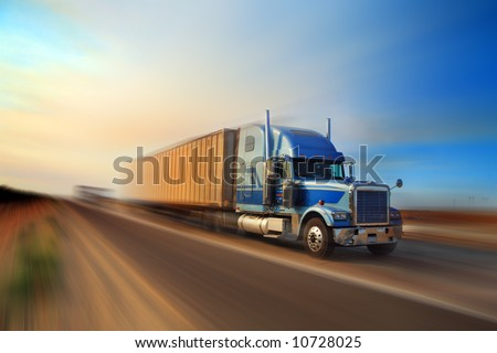 American truck speeding on freeway at sunset, motion blurred. #10728025