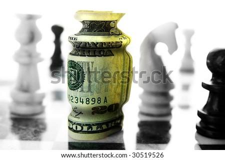 american twenty dollar bill on a chess board (financial risk or investment)