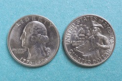 American US coins lie on a light blue background. Denomination: 25 cents, quarter, drummer, 1976. Both sides: obverse and reverse. XF condition. Declaration of Independence. View from above. Macro