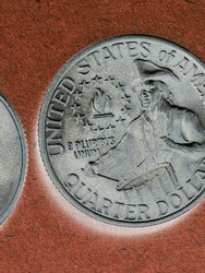 American US coins lie on brown background. Denomination: 25 cents, quarter, drummer, 1976. Declaration of Independence. View from above. Vertical shot. Inverted. Macro