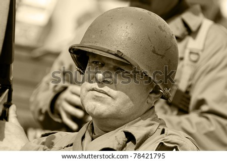 American veteran in helmet, vintage style (sephia color). - stock photo