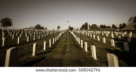 American Veterans Cemetery. Camp Nelson veterans cemetery with an American flag at the horizon.