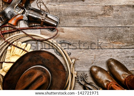 American West legend western cowboy ranching gear still life with old
