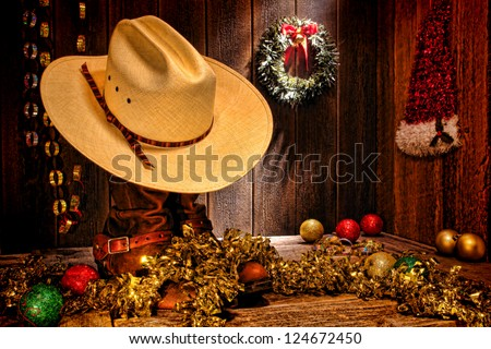 American West rodeo traditional white straw cowboy hat atop rancher boots with festive Christmas display decoration in authentic country wood barn for a nostalgic Western Christmastime greeting card