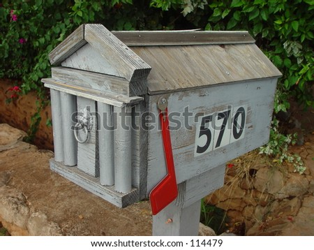 American wood mailbox with flag down