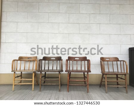 Americana rustic wooden chairs on old back deck horizontal