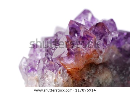 Amethyst crystal close up against white background