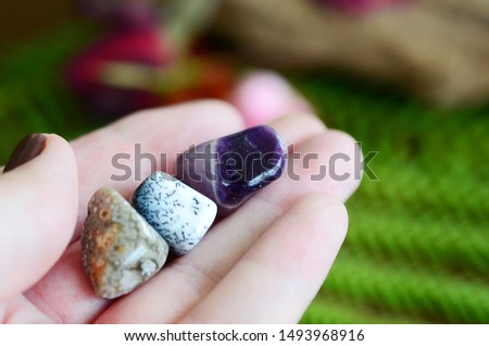 Amethyst, Dendritic Agate, and Ocean Jasper. Small sized crystal bundle. Woman's hand holding healing crystals. Crystals with intricate detail, macro photo of stones with natural lighting.  Tree agate #1493968916