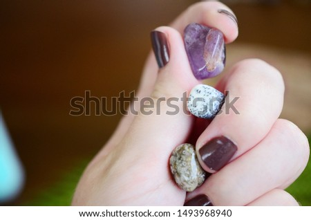 Amethyst, Dendritic Agate, and Ocean Jasper. Small sized crystal bundle. Woman's hand holding healing crystals. Crystals with intricate detail, macro photo of stones with natural lighting.  Tree agate #1493968940