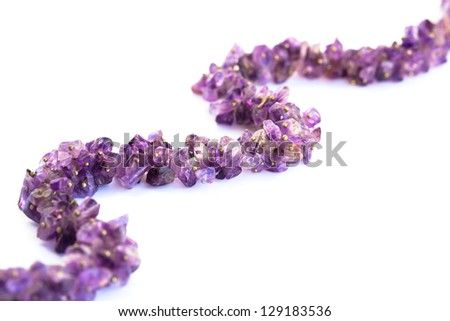 Amethyst necklace isolated on white background.