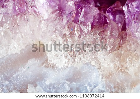 Amethyst. The texture of the mineral. Macro shooting of natural gemstone. The raw mineral. Abstract background.