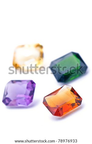 amethyst, tourmaline, citron colorful jewels isolated against a white background