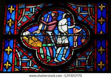 AMIENS - FEBRUARY 9: Stained glass window in the cathedral of Amiens, depicting the Massacre of the Innocents, a scene from the New Testament, in Amiens, France, on February 9, 2013. - stock photo