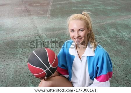 Amiling girl with basketball ball
