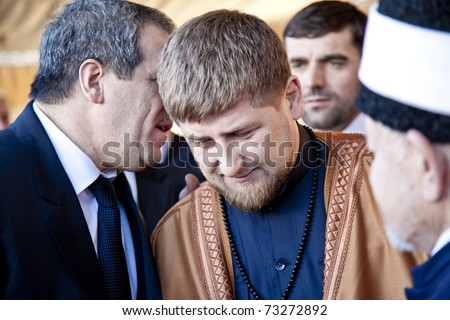 AMMAN, JORDAN - MAR 15: Vice president Ziad Sabsab translates to Chechen president Ramzan Kadyrov after accepting gift during visit to Jordan.  March 15, 2011 in Amman, Jordan.