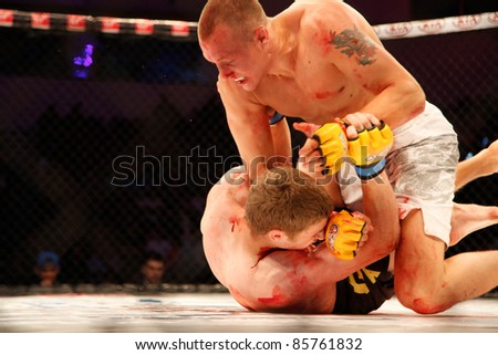 AMMAN, JORDAN - SEPTEMBER 8 : Jack Hermansson (Right)(Top) defeats Mike Ling (Left)(Bottom) by Knockout at 3:30 of Round 1,Cage Warriors Fight Night 2, Fight Card on September 8, 2011 in Amman, Jordan