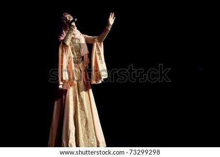 AMMAN - MARCH 15: Singer sagaipova from Chechnya performing for Jordanian Audience and royal family, during Kadyrov's visit to Jordan. March 15, 2011 in Amman, Jordan.