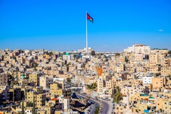 Amman midtown with the Jordan flag in the background