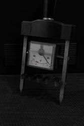 ammeter, old tool for measuring amps on black background