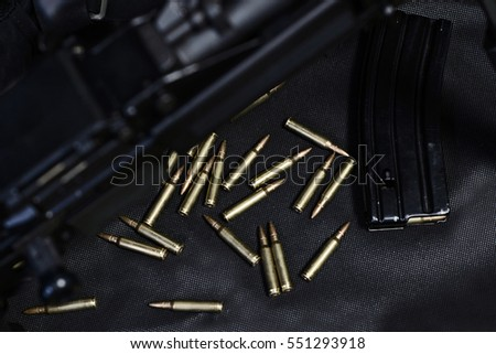 Stock Photo ammo to machine gun in the cage