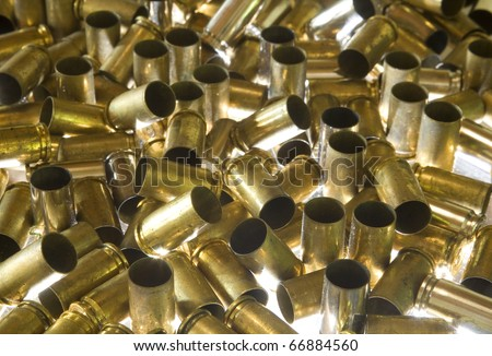 ammunition for a handgun that has been expended in a pile