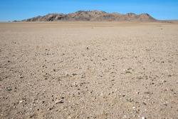 Among the rocky hill of dunes in the Gobi Desert
