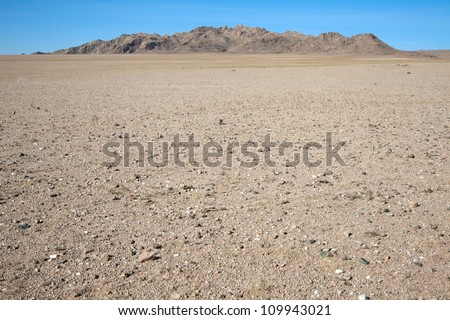 Among the rocky hill of dunes in the Gobi Desert