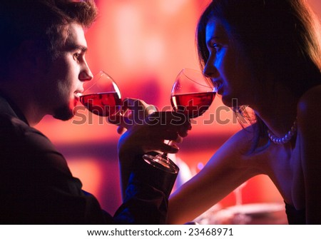 Amorous couple on romantic date or celebrating together at restaurant - stock photo