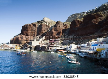 amoudi bay the fishing harbor port built into the caldera on the greek cyclades island of santorini town of oia ia on the mediterranean sea