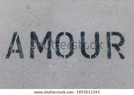 Photo of  Amour - Love stencil tag on urban street