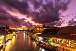 Amphawa floating market, The most famous of floating market with beautiful dramatic sky clouds, Cultural tourist destination in Thailand, Amphawa market canal, Samut songkhram Thailand.