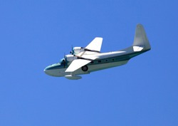 amphibious airplane searching above the sea
