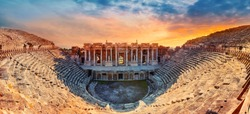 Amphitheater in ancient city of Hierapolis. Dramatic sunset sky. Unesco Cultural Heritage Monument. Pamukkale, Turkey