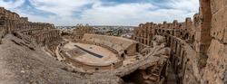 Amphitheatre of El Jem in Tunisia. Amphitheatre is in the modern-day city of El Djem, Tunisia, formerly Thysdrus in the Roman province of Africa. It is listed by UNESCO since 1979 World Heritage