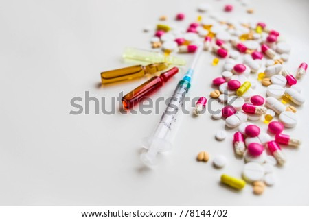 ampoules and syringe on white background. medical ampoules with syringe isolated. selective focus. Medicine in vials and syringe ready for injection. Copy space