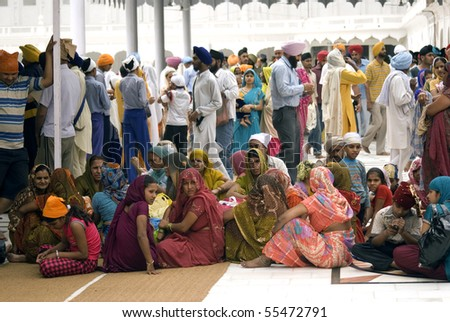 AMRITSAR, INDIA - APRIL 30: Sikh pilgrims in the Golden Temple during Full Moon Festival at April 30, 2010 in Amritsar, Punjab, India.