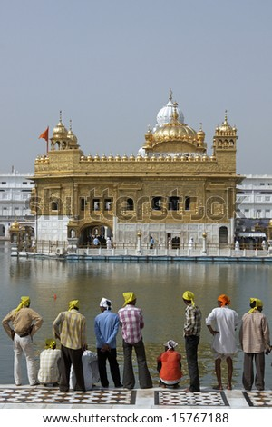 AMRITSAR, INDIA - JULY 24: Unidentified group of Indian men standing in front of the Golden Temple. July 24, 2008 in Amritsar, Punjab, India.