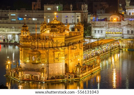 Amritsar, India - March 30, 2016: Golden Temple (Harmandir Sahib) at night in Amritsar, Punjab, India #556131043