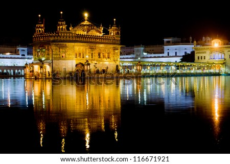 AMRITSAR, INDIA - OCTOBER 17: Sikh pilgrims in the Golden Temple during celebration day in October 17, 2012 in Amritsar, Punjab, India. Harmandir Sahib is the holiest pilgrim site for the Sikhs.