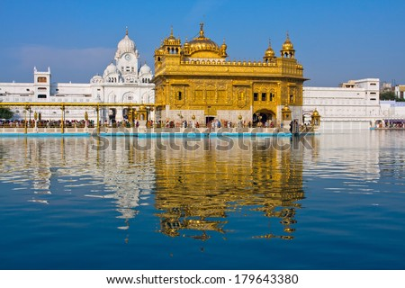 AMRITSAR, INDIA - OCTOBER 19: Sikh pilgrims in the Golden Temple during celebration day in October 19, 2012 in Amritsar, Punjab, India. Harmandir Sahib is the holiest pilgrim site for the Sikhs.