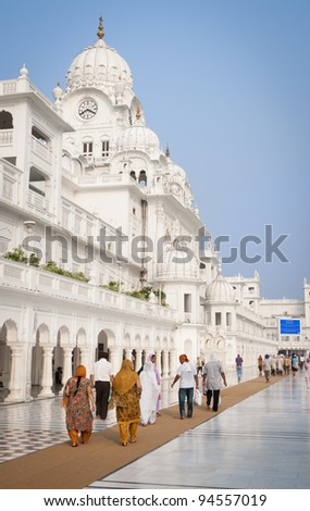AMRITSAR, PUNJAB, INDIA - AUGUST 26: Unidentified pilgrims walk in the Harmandir Sahib Complex, the spiritual and cultural center of the Sikh religion on  August 26, 2011 in Amritsar, Punjab, India